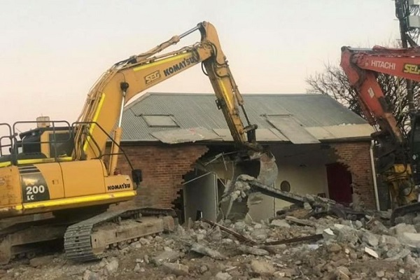Investigation begins into how Sydney gym was knocked down during nearby demolition