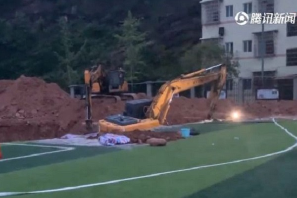 Whistleblower's remains found buried under Chinese school sport facility