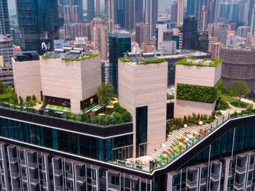Hong Kong rooftop development features swimming pool, gardens gym and event space