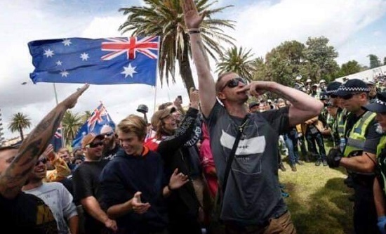 Victoria Police keep rivals protest groups apart at St Kilda beach